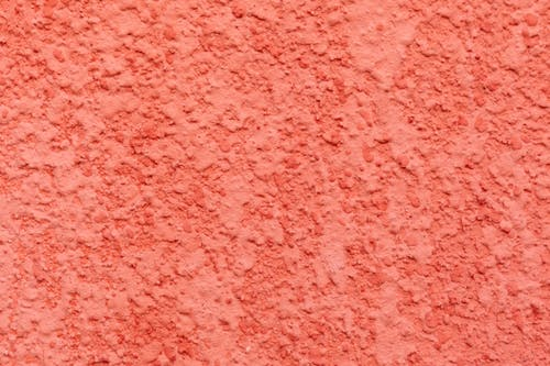 Coral stucco background of bright wall