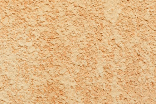 Beige texture of stucco wall of building