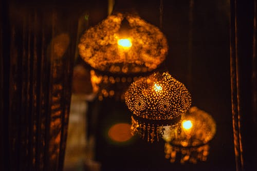 Glowing oriental lamps hanging on ceiling