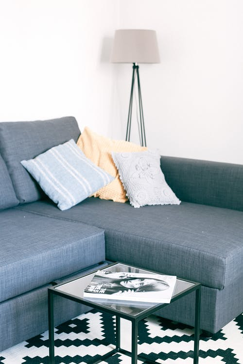 Living room interior with cozy sofa and small table