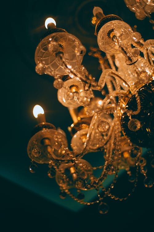 Chandelier with ornament and shiny lights in darkness