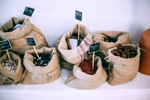 Different types of beans in sacks with inscriptions
