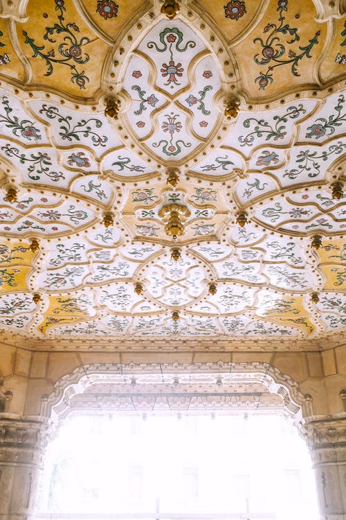 Ornamental ceiling in old masonry palace in sunshine