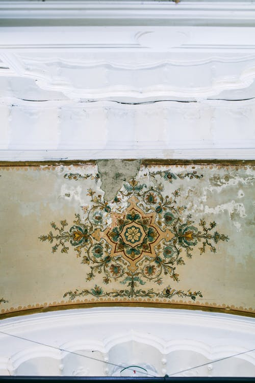 Ornamental ceiling with old painting in building