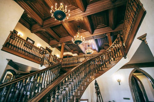 Wooden staircase in ornate hall of house