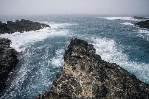 Rocky formations in blue stormy sea