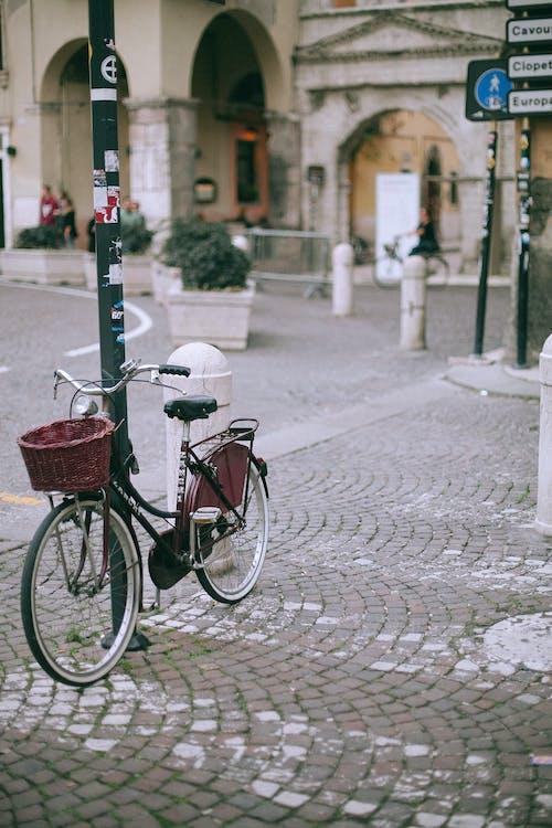 Bike parked on sidewalk near road