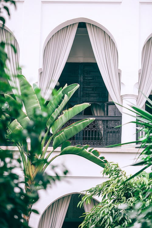 White arched balcony with metal railings