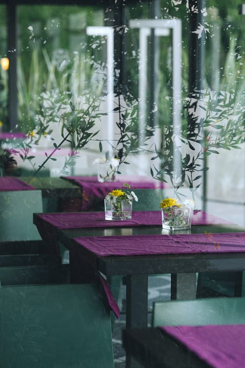 Table decorated with flowers in cafe