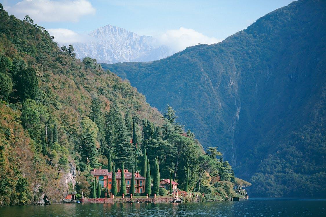 Breathtaking landscape of green mountains near lake