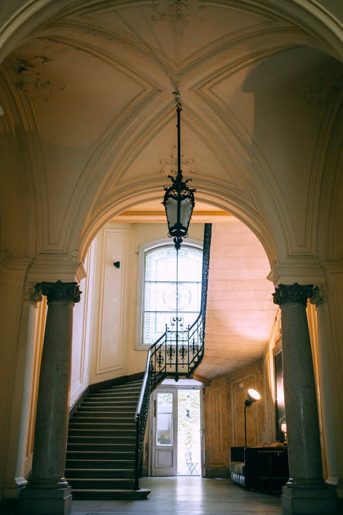 Old building interior with stairs and columns