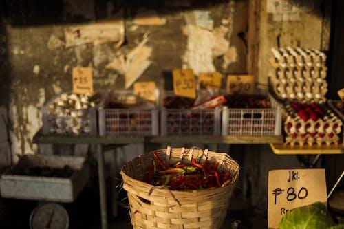 Wicker basket with pepper on market