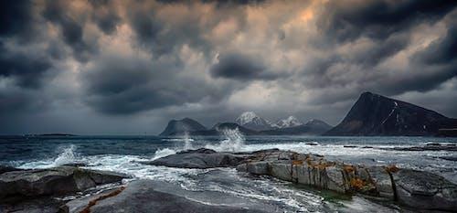 Stormy sea with splashing water under gloomy sky
