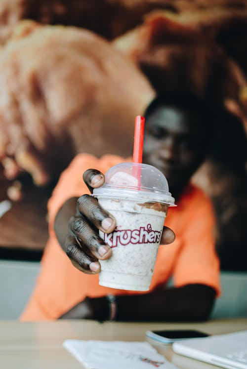 Woman Holding Dunkin Donuts Cup