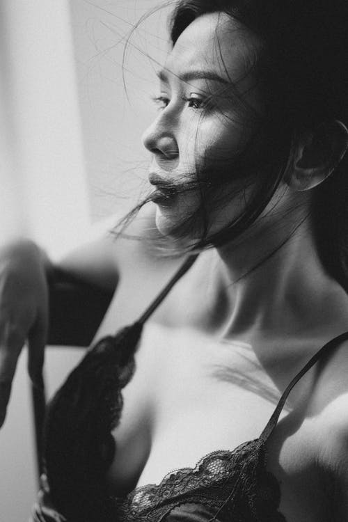 Asian woman in lingerie looking away