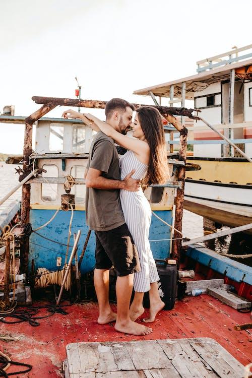 Romantic couple bonding on old boat