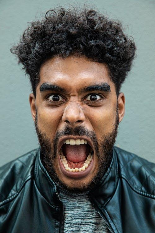 Close Up Photo of a Man Shouting