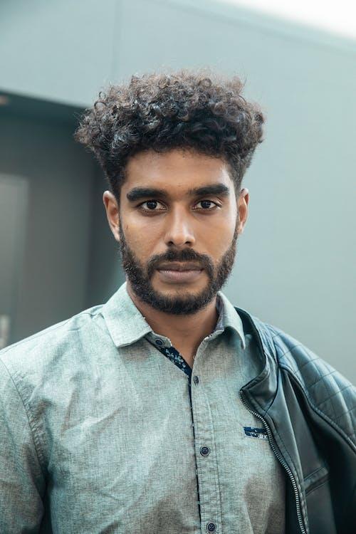 Bearded Man Wearing Gray Button Up Shirt