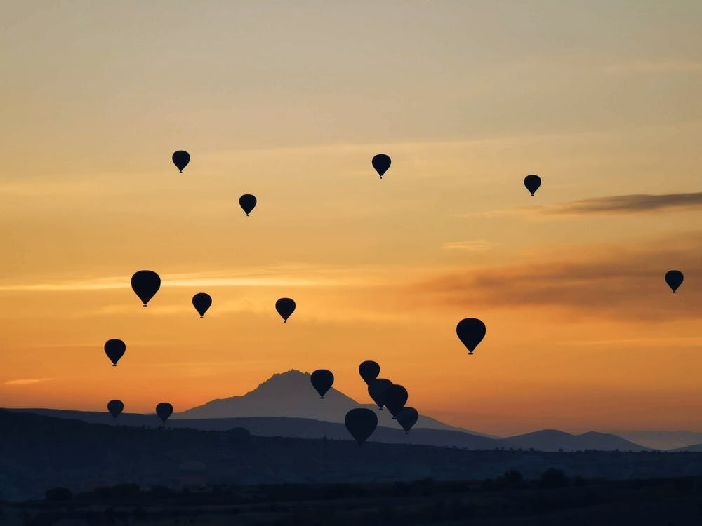 Bunch of air balloons at sunset