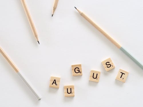 Composition of august letters on table