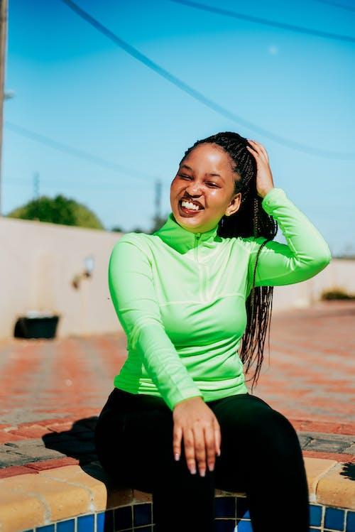 Cheerful young black woman enjoying sunny day