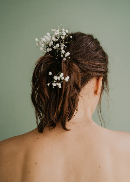 Woman With White Flower on Her Hair