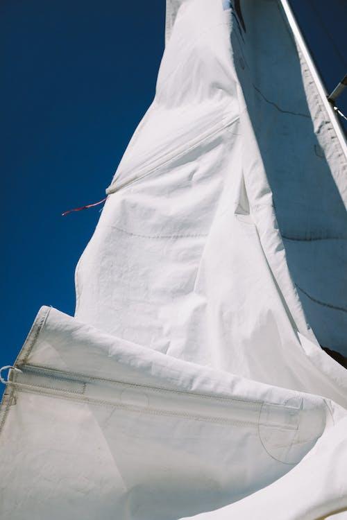 White Textile Under Blue Sky