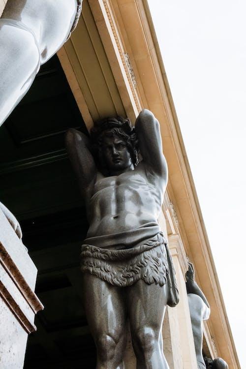 Angel Statue Under White Sky