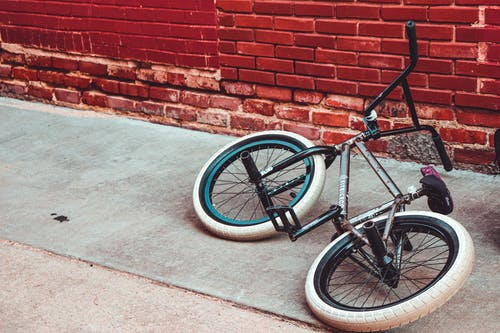 Free stock photo of abstract background, action shot, alleyway, bike