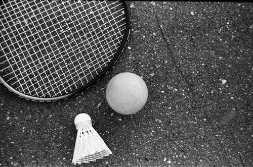 Tennis equipment placed on rough asphalt road