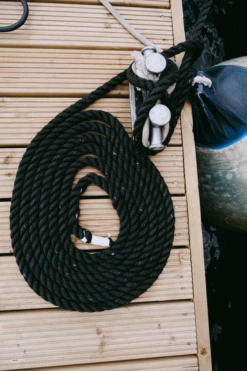 Black Rope on Brown Wooden Table