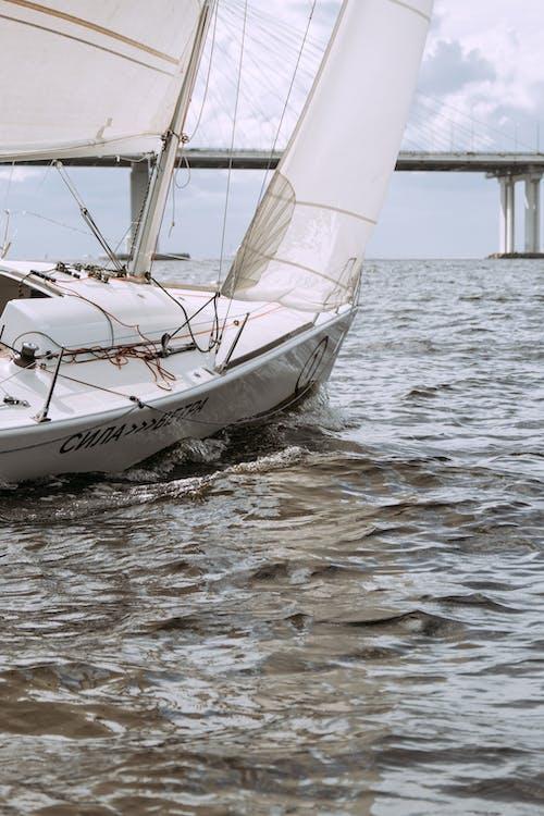 White Sail Boat on Sea