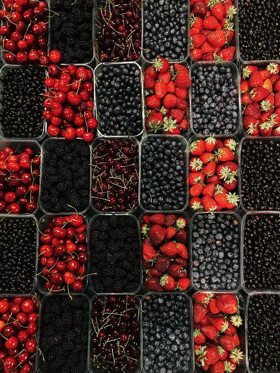 Red and Black Berries on Black Plastic Container