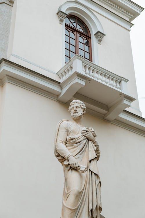 White Concrete Statue of a Woman