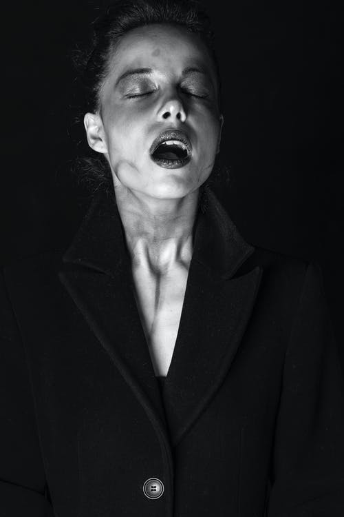 Grayscale Photo of Woman in Black Suit Jacket