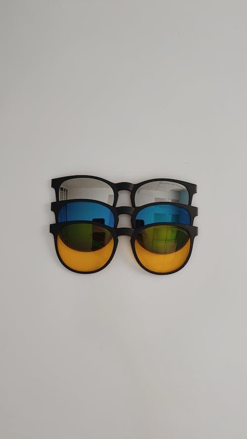 Collection of stylish feminine sunglasses on white background