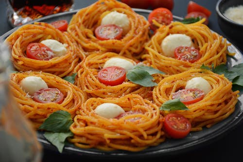 Delicious spaghetti with fresh cherry tomatoes and cheese for lunch