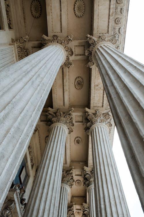 White Concrete Pillar Inside Building