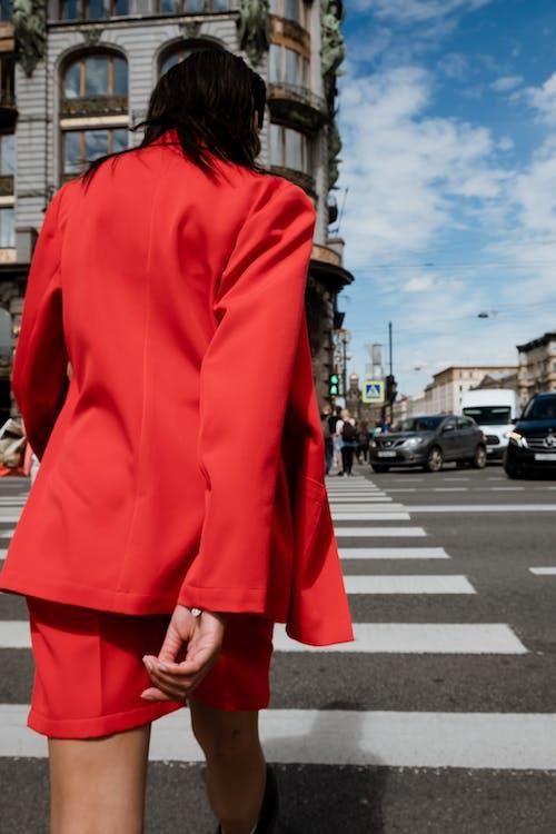 Woman in Red Coat Standing on Pedestrian Lane