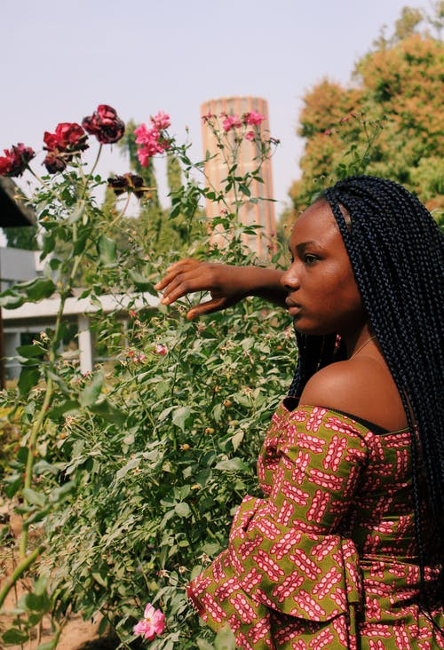 Emotionless black woman in garden