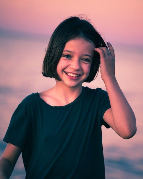 Optimistic little girl in light of sunset