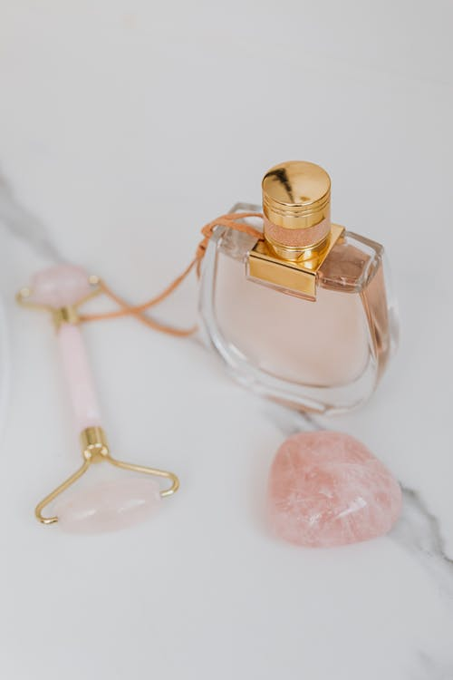 Clear Glass Perfume Bottle With Pink Heart Shaped Candy