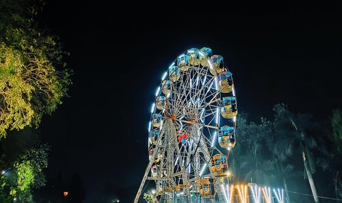 Ferris Wheel With Lights Turned on during Night Time