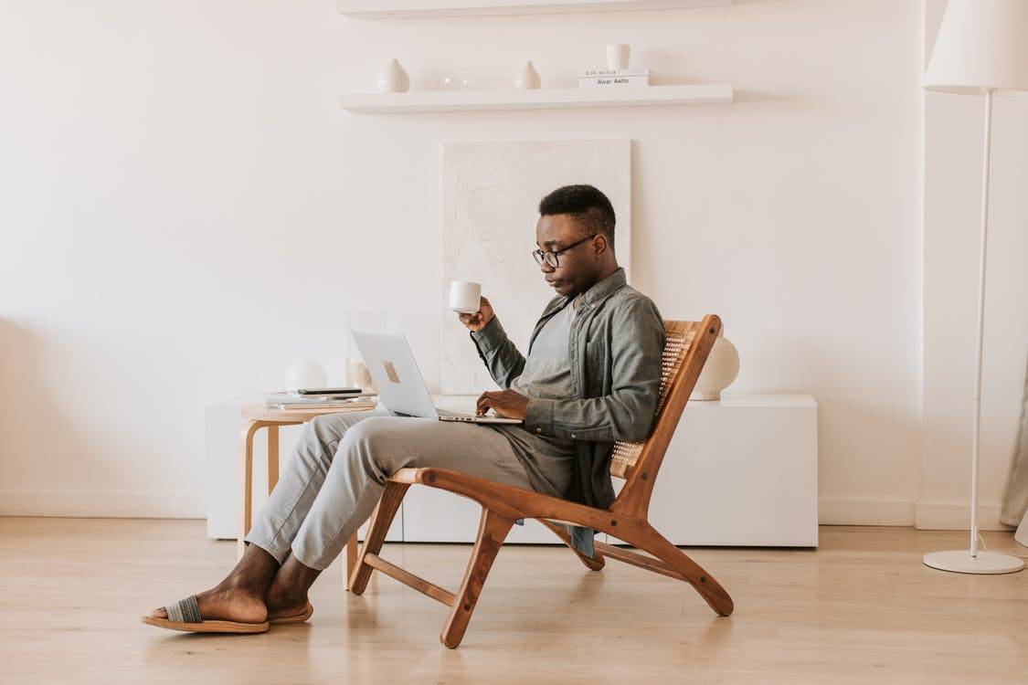 Man Sitting With a Laptop on his Lap