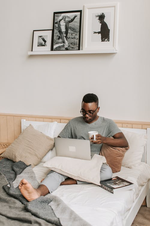 Man Sitting in Bed With His Laptop