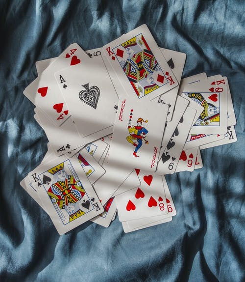Playing Cards on Blue Textile