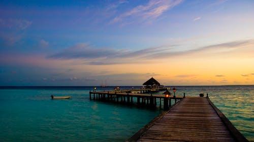 ahşap iskele, ahşap plakalar, bulutlar, cennet içeren Ücretsiz stok fotoğraf