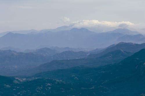 Rocky mountain peaks against misty evening sky