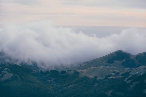 Mountain ridge against foggy sundown sky