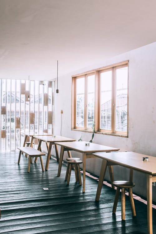 Wooden furniture in cozy minimalist cafeteria